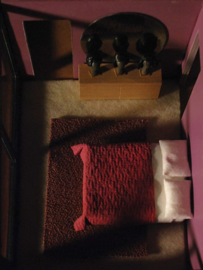 Photo of a built miniature bed taken from an aerial perspective.