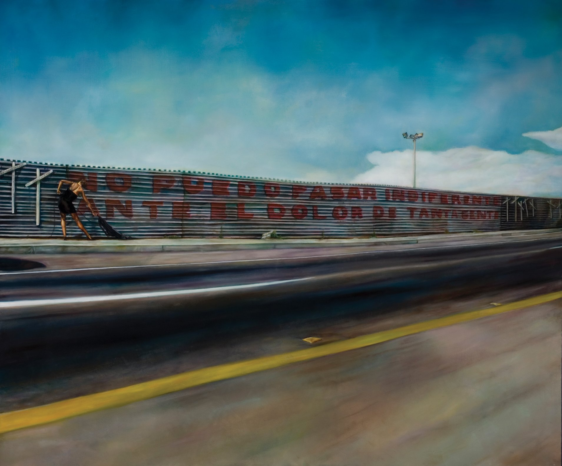 "Painting of the Mexican-American border wall bearing white crosses and the words, ""I can't stand to be indifferent among the pain of so many people,"" in front of which a woman in a cocktail dress vacuums."