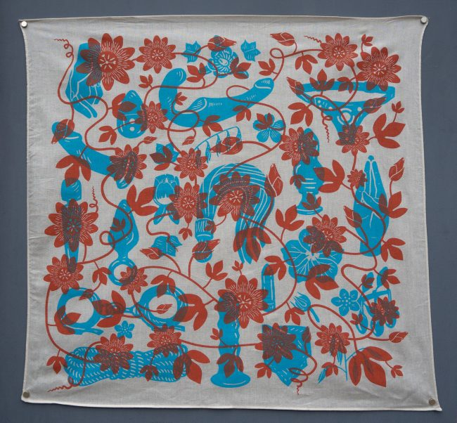 A white hanky featuring a variety of bright blue sex toys overlaid with red flowers on a vine