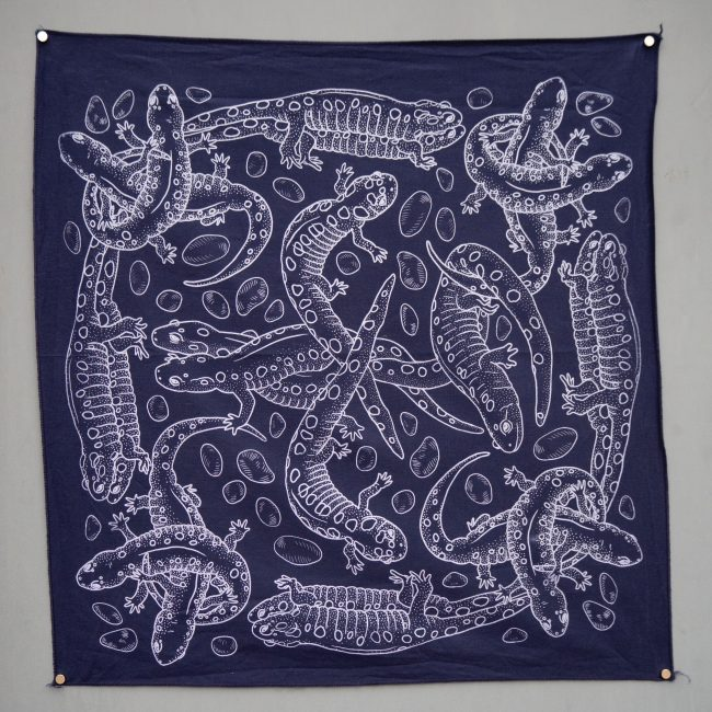 Several white salamanders climbing over one another, printed on a navy hanky